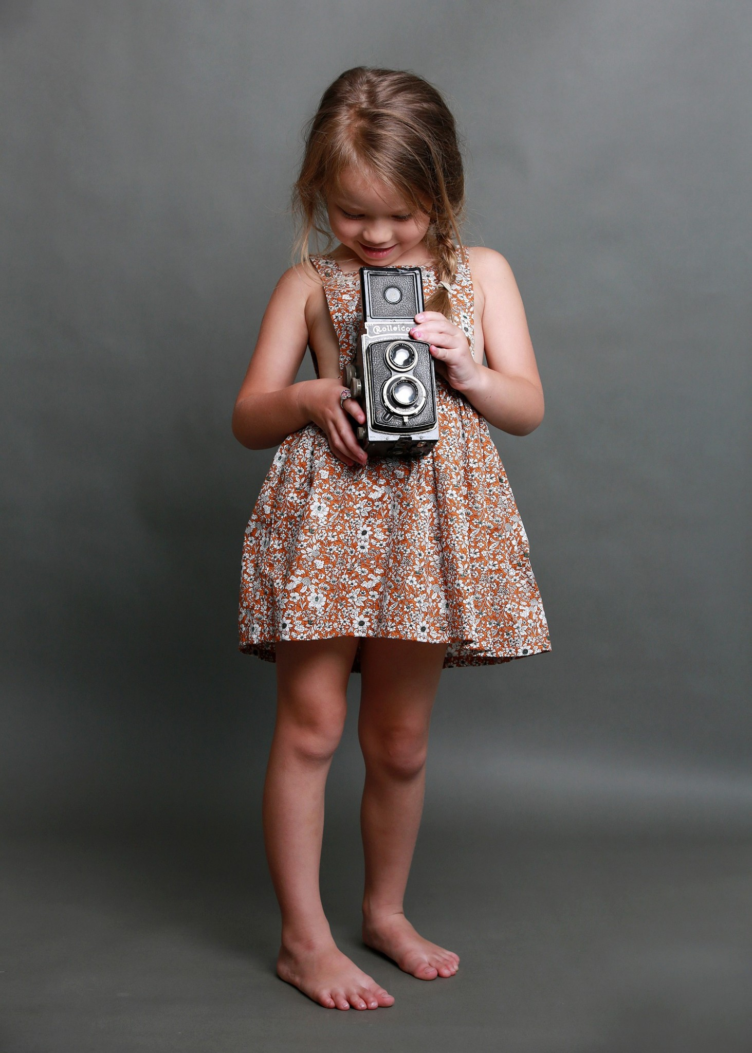 Girl Holding old Camera
