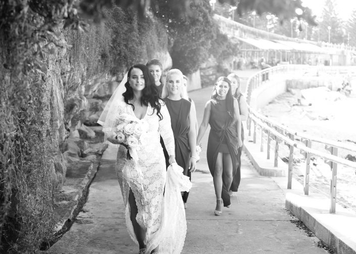 bridal party walking on boardwalk