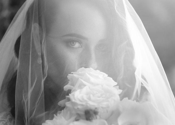bride behind veil