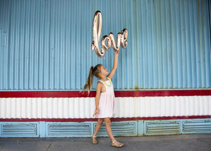Child Holding Love Balloon